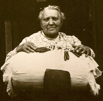A Mrs Sarah Harman displaying the pillow and bobbins