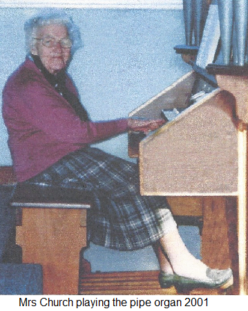 Mrs. Church playing the pipe Organ 2001