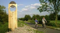 Cyclists passing 	 one of the many interesting resting places