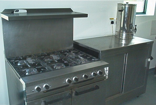 Gas double 	oven with six ring hob, 	hot food cabinet and portable hot water urn